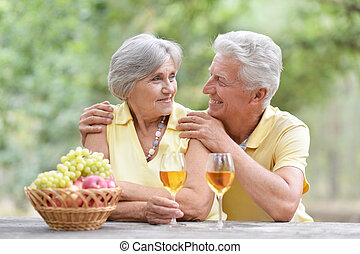 Old couple drinking