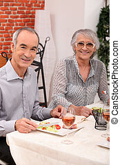 old couple eating at a restaurant