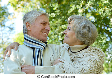 Old couple in autumn park