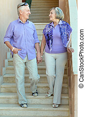 Old couple on stairs