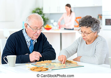 Old couple playing a game