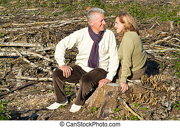 old couple sitting at ground