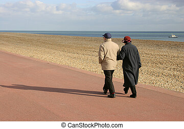 Retired pair together on sunny promenade