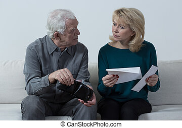 Old couple with financial difficulties