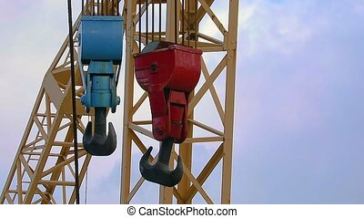Old Crane Hook - Heavy old steel hooks in a port swinging in...