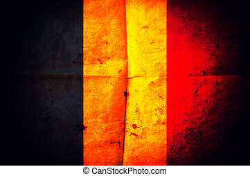 Old creased paper with Belgian flag as the background