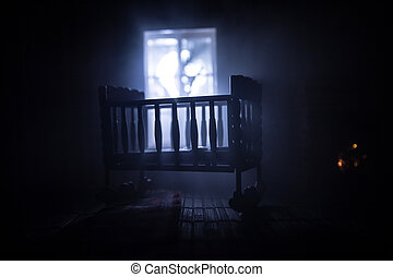 Old creepy eerie baby crib near window in dark room. Scary baby silhouette in dark. A realistic dollhouse living room with furniture and window at night
