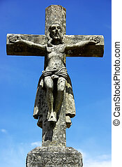 Old cross, and Christ in blue sky.