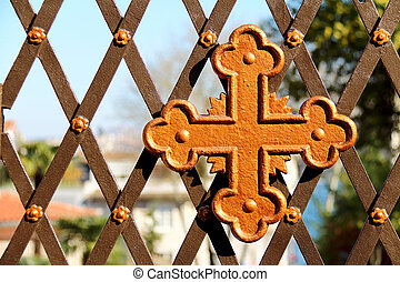 Old Cross Symbol On The Church Garden Door