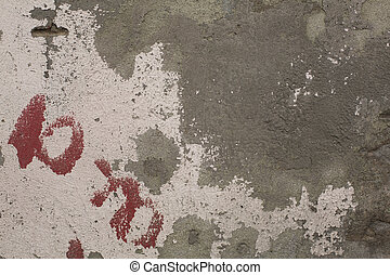 Old crumbling paint on gray plaster concrete wall texture -...