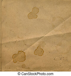 Old crumpled paper with stains of coffee or tea