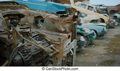 old crushed cars is lying in heaps on a rubbish dump...