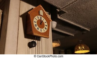 Old cuckoo clocks hanging on the camp in the room