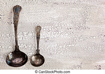Old cutlery cracked white wooden background