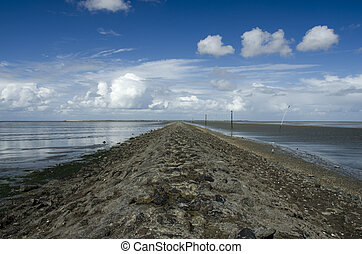 Old dam on the North Sea at low tide
