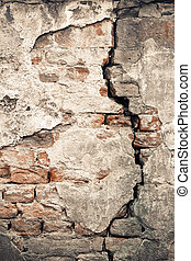 Old damaged wall with a big crack texture