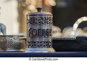 old decorated coffee container