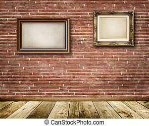 Old decorative frames on red brick wall.