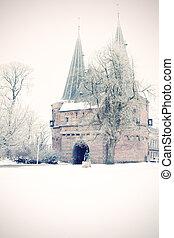 Old defense gate at Wintry city park in Kampen, Netherlands