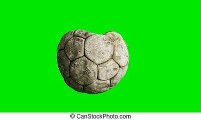 old deflated soccer ball on green chromakey background
