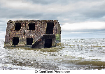 Abandoned fortifications at Baltic sea coast in Liepaja Latvia