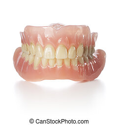 Old Dentures - Old dentures with yellowed teeth isolated on...