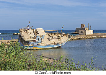 Old derelict shipwrecked boat abandoned on beach
