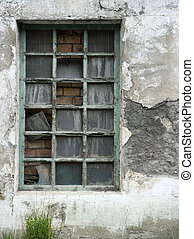 old derelict windows with flaky paint and broken window