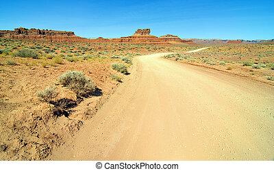 old desert dirt road in monument valley utah