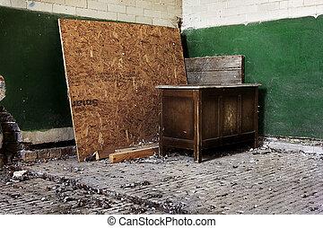 Old desk in abandoned building