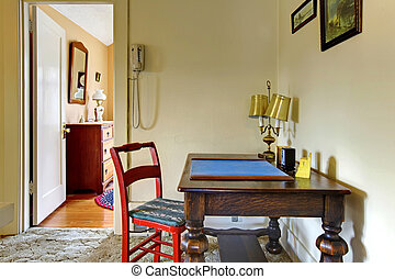 Old desk in hallway English charming house.