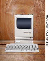 Old desktop computer in vintage wood room