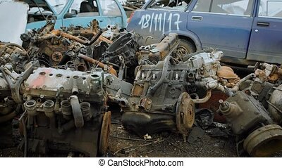 Old destroyed engines on scrapyard - Plenty of rusty wrecked...