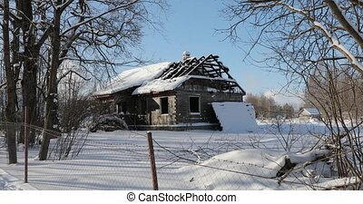 old destroyed house in winter afternoon clear weather.