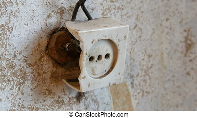 Old destroyed vintage socket in wall of the house - Old...