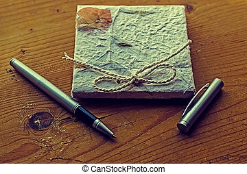 Old diary memories with pen on a wooden table
