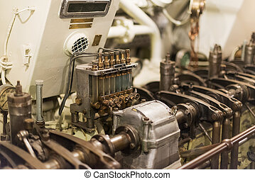 Old diesel engine inside of submarine.