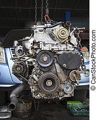 old diesel engine of light truck maintenance in garage...