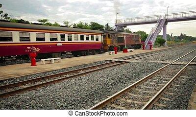 Old Diesel Locomotive Pulling Passenger Train in Thailand -...