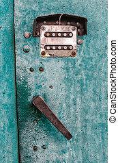 old digital combination lock on an iron door