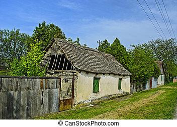 Old dilapidated farmhouse awaiting demolition or repair.