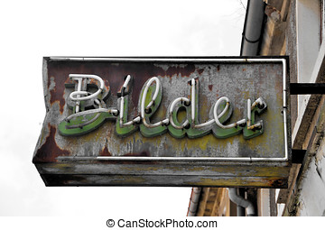 old dilapidated neon sign a former photo shop with the words...
