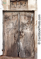 Old dilapidated wooden door. Rajasthan, India