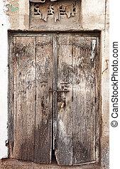 Old dilapidated wooden door. Rajasthan, India