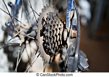 Old dirty bicycle parts, gears and rear derailleur