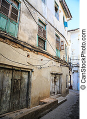 Old dirty buildings in a street in an african city