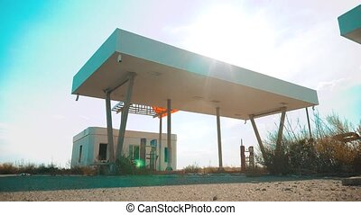 Old dirty deserted gas station. U.S. Route 66. crisis road 66 fueling slow motion video. closed supermarket store shop Abandoned gas station oil end of fuel the world lifestyle apocalypse petrol. main street of america. mother of the roads. mother of the roads.