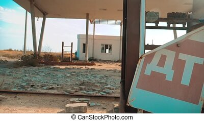 Old dirty deserted gas station. U.S. Route 66. crisis road 66 fueling slow motion video. closed supermarket lifestyle store shop Abandoned gas station oil end of fuel the world apocalypse petrol. main street of america. mother of the roads. mother of the roads.
