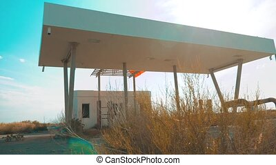 Old dirty deserted gas station. U.S. Route 66. crisis road...