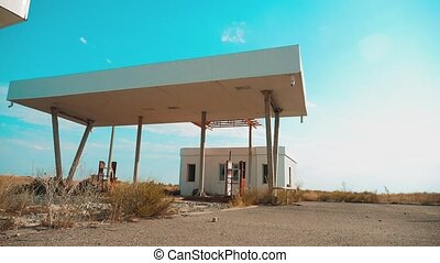 Old dirty deserted lifestyle gas station. U.S. Route 66. crisis road 66 fueling slow motion video. closed supermarket store shop Abandoned gas station oil end of fuel the world apocalypse petrol. main street of america. mother of the roads. mother of the roads.